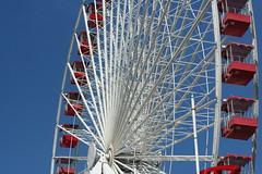 Navy Pier Wheel (stpauliesgirl) Tags: blue red sky white chicago color illinois ride sightseeing ferriswheel amusementpark navypier circular linesandcurves flickrstas