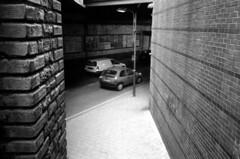 006 (Blacknoise) Tags: road 2 urban bw white black brick cars film home wall 35mm dark diy leeds delta arches olympus xa2 iso 400 push analogue xa pushed process 800 processed hc ilford compact ilforddelta ilfotec