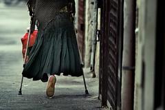 Life Support (Gilad Benari) Tags: life street urban woman art print poster dead israel sad expression tel aviv leg streetphotography streetlife   crutch harsh gilad limp documentry lifesupport hardlife oneleg   limping harsg cruthes benari leadingtheeye