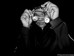 Introversion (Monerxz) Tags: blackandwhite bw selfportrait night self eyes holding hands philippines carlos headset jacket filipino raymond pinoy earphones pilipinas introvert introversion abagat raymondcarlosabagat