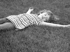 Lay In The Grass (Brave Heart) Tags: nov summer blackandwhite bw white black grass fun photo lily lawn relaxing picture resting 2007 layinginthegrass layinthegrass