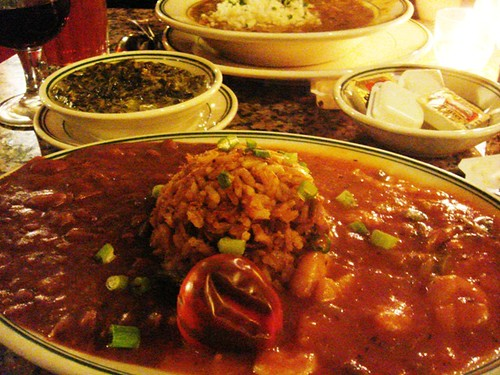 Clockwise from top: chicken andouille gumbo, shrimp creole, jambalaya, red beans & rice, and creole creamed spinach