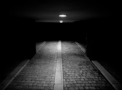 Into the darkness (Barry McGrath) Tags: street new city uk urban bw white black london night canon eos lights blackwhite holidays december cityscape darkness path empty providence wharf lonely canary emptiness lonliness 2007 30d aplusphoto canonefs1785f456is