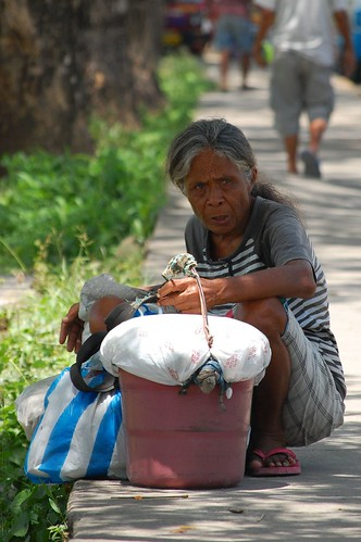Elderly woman rest beside a footpath Cebu  Consolacion Public Market Pinoy Filipino Pilipino Buhay  people pictures photos life Philippinen  菲律宾  菲律賓  필리핀(공화국) Philippines