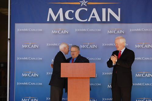 Senator John McCain whispering in Rev. Hagee's ear.