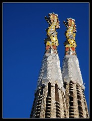 Sagrada Famlia (MarcelGermain) Tags: barcelona blue red 2 two sky building church monument yellow stone architecture geotagged nikon colorful europe basilica modernism landmark catalonia gaudi gaud catalunya sagradafamilia myfavourites modernisme sagradafamlia polariser eixample 10faves d80 mywinners aplusphoto marcelgermain
