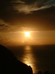 Sunset from Woody Bay (gregwake) Tags: uk light sunset shadow sea england cliff sun mist holiday sol water rock wales clouds gold golden see solar meer waves fuji bright britain dusk h2o devon flare gb ripples sonne 2007 westcountry gbr bristolchannel woodybay