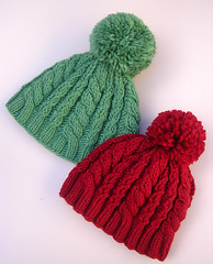 Snowball Hats - Interweave Knits Fall 2007 (kathrynivy.com) Tags: wool hat knitting knit merino cables knits pompom pompon cabled malabrigo interweave fall2007 kathrynivy cascade109 snowballhat alicegracehats2008