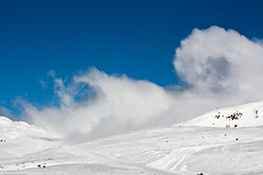 Twisting clouds (Shutter Moments) Tags: sky snow mountains weather wind turbulence re
