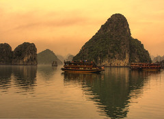 Dawn on Halong Bay - Vietnam (trickyd3) Tags: beautiful rock sunrise reflections boats dawn islands tranqulity peaceful tranquility vietnam limestone fareast halongbay worldheritage stillwaters diamondclassphotographer flickrdiamond absolutelystunningscapes