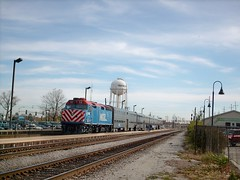 An eastbound Metra commuter local slows down for the station stop in Franklin Park Illinois. October 2007.
