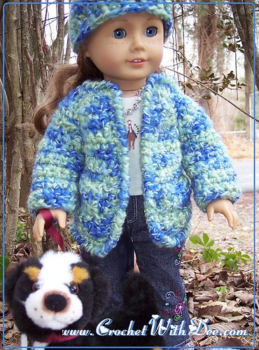 American Girl, Nikki, models sweater & cap set designed by Dee Stanziano