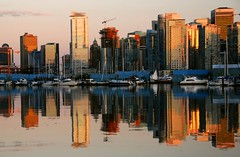 Vancouver sunset (jurek d.) Tags: sunset canada reflection vancouver boats cityscape skyscrapers crane britishcolumbia reflexions jurekd