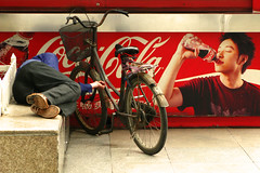Coke adds life (Life in AsiaNZ) Tags: life china city sleeping people man bicycle canon advertising asia hand seat south chinese powershot southern cocacola   slogan claims false nanning  guangxi    g9   gseries  canong9 cokeaddslife lifeinnanning  flickrgiants