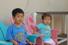 Owen and Aki sitting in little adirondack chairs