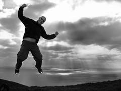Jump for Joy (happyrach8) Tags: ocean uk light england blackandwhite bw cloud white black english clouds jump ray unitedkingdom south dorset british sunray seatown lymebay bwdreams