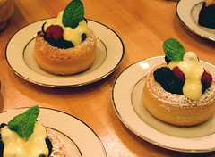 Berry Savarin with warm Sabayon Sauce (purpletwinkie) Tags: baba savarin baked food dessert cakes soaked syrup vanilla round circles sponge yeast dough mint berries blueberry raspberry bluberry powdered sugar canon eos digital rebel xt thechallengefactory