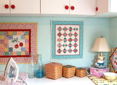 Aqua office wall (Happy Zombie) Tags: red aqua quilt fabric organization sewingroom redandaqua
