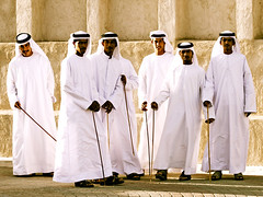 young emiratis - dubai (Emmanuel Catteau photography) Tags: world trip vacation portrait people holiday heritage history tourism face festival person dance dubai photographer gulf song group performance reporter meeting visit east emirates human national planet stick lonely local tradition middle ethnic exploration geo geographic photographe dishdash       catteau    kandura   globetrotteur   wwwemmanuelcatteaucom emmanuelcatteau