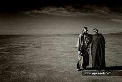 Abdul & Ismael in Lake Iriqui (wprasek) Tags: people blackandwhite bw orange lake hot nature ecology monochrome landscape ma person blackwhite costume clothing sand friend scenery rocks quiet open dress flat robe empty muslim dry sunny monochromatic buddy clothes dirt relationship morocco berber human windswept land hood environment nomad cloak tribe mate desolate relationships barren matey plain environmentalism deserted abdul humanbeing humans harsh islamic traditionaldress smock ecosystem robes humanbeings ismael hooded nomadic attire westernsaharadesert folioworldcultures warrenprasek iriqui nearalgerianborder lakeiriqui xoodu wprasek wwwxooducom wwwwprasekcom