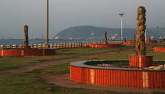 Dolphin Nose (sanmang610) Tags: morning red sea orange sun india seascape beach water statue horizontal sunrise landscape nose seaside ray shine dolphin hill pillar statues vizag