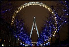 The London Eye (Sartori Simone) Tags: uk greatbritain blue trees england london yellow geotagged gold lights europa europe londoneye southbank londres gb londra granbretagna inghilterra allrightsreserved simonesartori prospettivaformica diamondclassphotographer