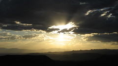 Explosion. (lumberjacklukee) Tags: blue sunset cloud mountain mountains beautiful beauty yellow clouds utah interestingness interesting desert hill explosion hills mostfavorited sillouette zion zionnationalpark onetopfav exploretop20 abigfave anawesomeshot impressedbeauty