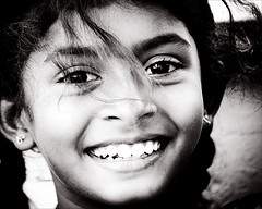 Little Miss Sunshine (gunnisal) Tags: street portrait people bw girl smile child faces joy young sri lanka olympuse500 iloveyoursmile aplusphoto peopleofsrilanka