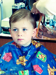 Young boy haircut (BACHarbin) Tags: family boy usa haircut male kid clothing child candid thoughtful apron scissors photoblog barbershop va pensive hairsalon youngster comb unsure chantilly haircutting gettingahaircut submittedtophotoshelter