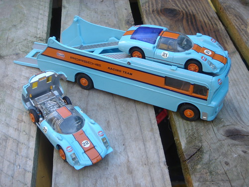 This model was presented with 2 Corgi Carrera racing cars in complementing
