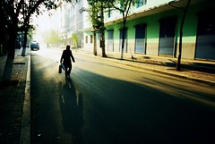 . (GraemeNicol) Tags: china street city shadow urban woman sunlight reflection asia silouhette jilin  tonghua