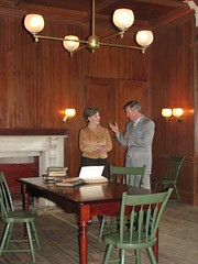 Mrs. Bush and Director Frank Milligan discuss Lincoln's love of literature in the library at President Lincoln's Cottage.