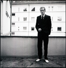 ---|- (romanraetzke) Tags: bw selfportrait man analog self mediumformat blackwhite shoes balkon hasselblad squareformat mann schwarzweis selbstportrait blick anzug stehen selbstauslöser mittelformat