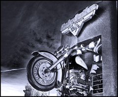 Terminator Hog (vgm8383) Tags: blackandwhite bw building window bike wheel sign metal canon rebel blackwhite cafe break arnold engine strip harleydavidson motorcycle thestrip terminator hog handlebars ahnold xti 400d abigfave rebelxti anawesomeshot superbmasterpiece diamondclassphotographer megashot diamondexcapture theperfectphotographer goldstaraward