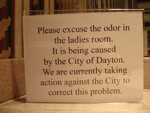 Please excuse the odor in the ladies room. It is being caused by the City of Dayton. We are currently taking action against the City to correct this problem.