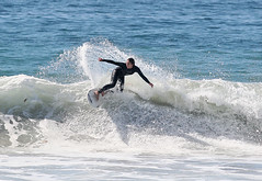 Girl Carving a Wave 7313 (casch52) Tags: ocean california county summer woman 20d beach wet water girl sport canon fun photo cool sand san surf waves sandiego action surfer board wave diego surfing 300mm suit photograph oceanside surfboard wipeout southerncalifornia solano wetsuit encinitas surfergirl reentry 14x f4l