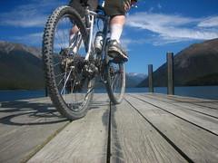 Ride By (B A Hockman) Tags: blue newzealand mountain lake mountains bike freedom view ride jetty ontheroad touring lakerotoiti onthetrail nelsonlakesnationalpark starnaud onyerbike marlboroughexploration