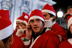 'Can you bring home a packet of penguinburgers, dear?' (Dean Ayres) Tags: london mobile santas phone piccadillycircus fatherchristmas santacon santaclause