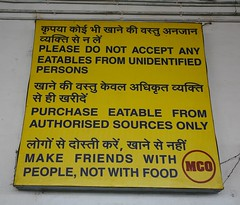 Funny Food dangers at Gwalior station, Madya Pradesh, India (greenwood100) Tags: travel friends food india station sign yellow words funny priceless rail railway humour eat crime snack laugh language script gwalior hindi shocking pradesh madhyapradesh madya devanagari devanagariscript devangari