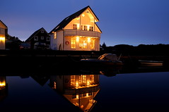 Mirage Boathouse (Trondelarius) Tags: christmas winter sunset sea house west building norway night reflections landscape boats mirror coast norge vinter cabin nikon horizon cottage wharf mirage vest jul luxury hordaland natt skumring hytte austevoll noreg d300 rorbu boatlife speiling d300hordaland