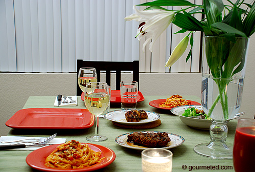 Valentine's Day dinner of salad with gorgonzola vinaigrette, seared scallops, grilled rib eye steak, linguine with tomato basil sauce, wine