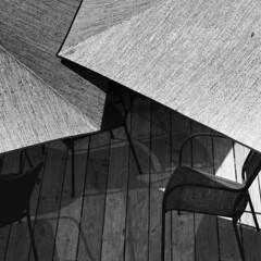 {shy} (pam ullman) Tags: bw shadows chairs shapes shy utata umbrellas chestercountypa stpetersvillage thursdaywalk utata:color=black utata:project=tw111