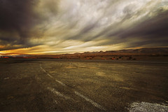 (parade in the sky) Tags: california mountains car clouds landscape highway driving traffic ground wideangle dirt roadside 1020mm gravel
