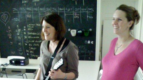 Lisa and Gill rocking Guitar Hero and smiling