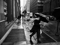 WINDY DAY (joewig) Tags: street nyc urban blackandwhite bw woman blackwhite interestingness rainyday streetphotography parkavenue ricohgrd lifeinsevenpages