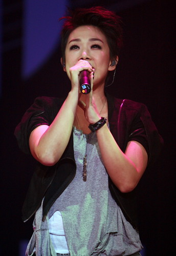 Cantopop singer Sandy Lam performing on stage in 2009