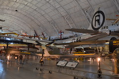 Steven F. Udvar-Hazy Center: British Hawker Hurricane, with P-38 Lightning and B-29 Enola Gay behind it (Chris Devers) Tags: japan plane airplane virginia smithsonian dulles fighter unitedstates martin aircraft hurricane rollsroyce hiroshima worldwarii va british spitfire boeing fairfax bomber nationalairandspacemuseum raf hawker atomicbomb dullesairport chantilly enolagay airandspacemuseum worldwartwo udvarhazy b29 superfortress battleofbritain smithsonianinstitution supermarine nuclearweapon stevenfudvarhazycenter p38lightning hawkerhurricane royalairforce supermarinespitfire stevenfudvarhazy b29enolagay eyefi b2945mo b29superfortress exif:exposure_bias=0ev exif:focal_length=22mm exif:exposure=0017sec160 exif:iso_speed=800 hurricanemkiic hawkerhurricanemkiic exif:aperture=f38 camera:make=nikoncorporation exif:flash=offdidnotfire camera:model=nikond7000 flickrstats:favorites=1 exif:orientation=horizontalnormal exif:vari_program=autoflashoff exif:lens=18200mmf3556 exif:filename=dsc9901jpg exif:shutter_count=11414 meta:exif=1350345816