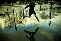 don't get your feet wet. ([phil h]) Tags: city winter urban 15fav paris france reflection wet topf25 topv111 wow jump jumping topf50 topv555 topf75 pavement topc50 fv5 topf300 topc100 fv10 blogged konica february a200 topf150 thursday topf100 maly topf250 topf200 2007 stumbleupon topf500 stumbled utatathursdaywalk43 pict9483lred1750 utata:project=tw43