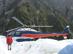 Helicopter landing on glacier