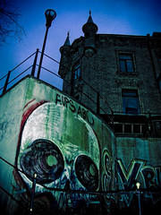 Old and new (gothicburg) Tags: streetart brick architecture dark gteborg skull sweden gothenburg olympusc5050z
